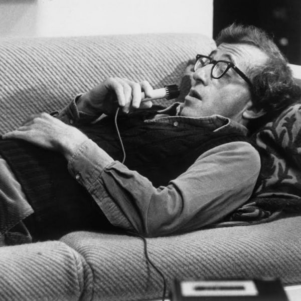 HANDOUT IMAGE: Comfortably at work on the living room, couch, write Isaac Davis (Woody Allen) dictates his ideas in a scene from